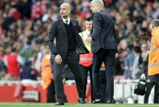 Arsene Wenger and Pep Guardiola on the touchline.