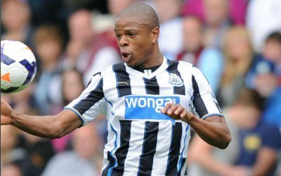 Loic Remy controls the ball with his chest during a game for Newcastle