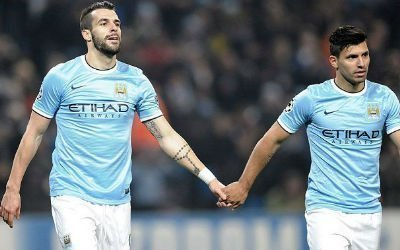 Sergio Aguero and Alvaro Negredo link hands whilst playing for Manchester City.